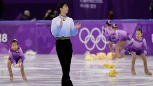 Why do fans of Japan figure skating champ Yuzuru Hanyu pelt him with Pooh Bears?