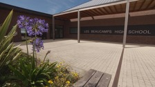 Les Beaucamps school in Guernsey is being considered as one of the potential sites for the States' two-school model of secondary education