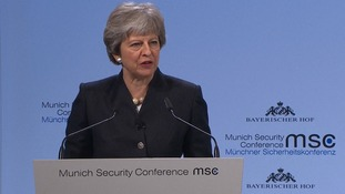 Theresa May addresses the conference.