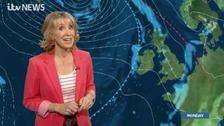 Emma Jesson in front of isobars and frontal weather graphic