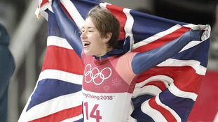 Lizzy Yarnold celebrates taking gold