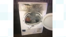 Two taken to hospital after tumble dryer fire