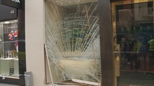 The shattered glass at the Rolex shop