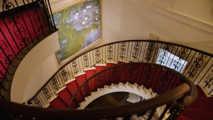 A Monet painting hung in David Rockefeller's stairway.