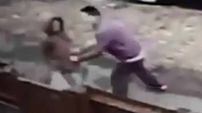 Footage shows girl, aged 12, attacked and robbed on busy street