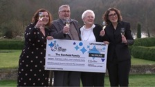 Lottery winners toast their £18.1m windfall