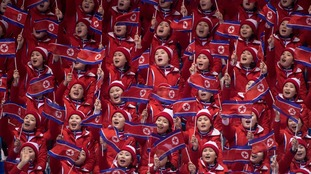 Members of a North Korean delegation cheer while waving their national flag at the pairs figure skating free program at the Pyeonchang Winter Olympics Thursday, February 15, 2018 in Gangneung, South Korea.