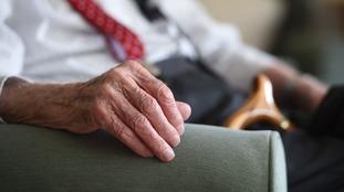 File photo of elderly man with walking stick
