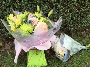 Flowers have been placed outside the semi-detached house
