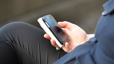 Mobile phone users 'receive 33,800 messages a year'