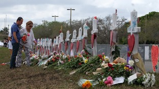 Tributes are left to the shooting victims.
