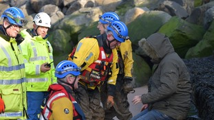 Chris being helped by the coastguard