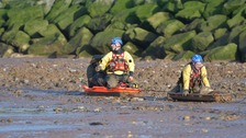 Dog walker rescued after getting stuck in sinking mud