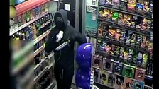 Shocking CCTV of shop-owner threatened with knife.