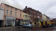 Multiple crews dealing with wine bar roof fire in Halstead
