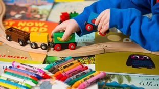 A child plays with a train