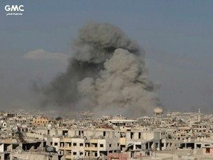 Bombs explode in a rebel-held area in Syria