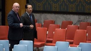 Russia's UN Ambassador Vassily Nebenzia (left)