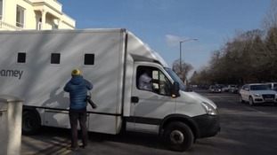 The van which Brown and Harrison were taken away from court in