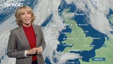 Emma Jesson in front of UK weather graphic