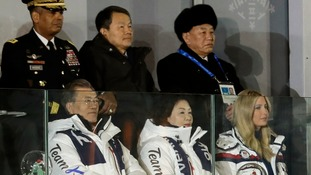 South Korean President Moon Jae-in (front left) has met with Kim Yong-chol (back right), North Korea's chief delegate to the Winter Olympics.