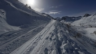 The three men were skiing in the French Alps.