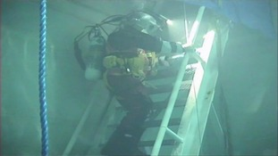 A specialist diver goes underwater