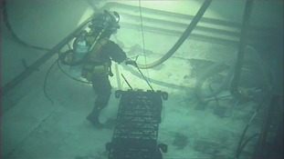 The specialist divers removing radioactive waste