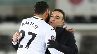Swansea City's Kyle Bartley and manager Carlos Carvalhal celebrate after the final whistle.