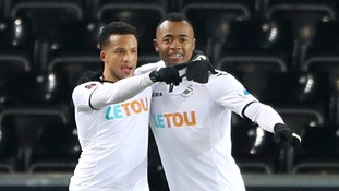 Jordan Ayew (right) celebrates scoring Swans' first goal against Sheffield Wednesday.