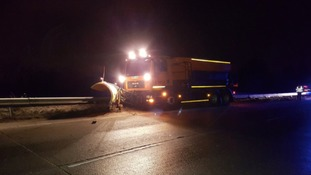 A gritter crashed into the central reservation of the A11