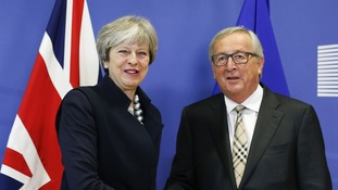 Theresa May and Jean-Claude Juncker during Brexit talks in December.