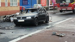 A burnt out car after the accident