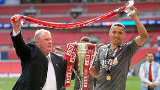 Evans helped Rotherham United win promotion to The Championship in 2014.