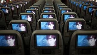 Seats and screens in the economy class cabin of the Qatar Airways Boeing 787 Dreamliner