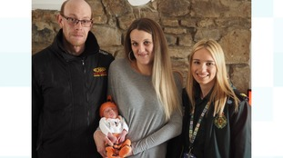 Gareth and Rhiannon with call handler Chelsie Holbrook (right), and baby Phillip Alan.