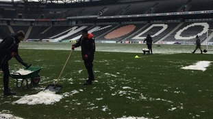 Volunteers have been working at Stadium MK clearing the pitch