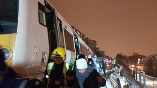 Passengers being helped from a train near Lewisham station in south London.