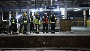 Emergency workers at Lewisham station after passengers frustrated by delays jumped from trains and walked down tracks.