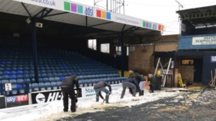 Fans spent much of the morning clearing snow