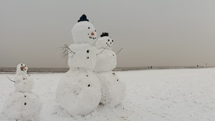 Forget sandcastles - now it's beach snowmen, and a host of other icy creations