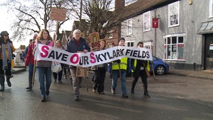 Protestors take to streets to march against housing plans