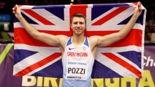 Pozzi celebrates his victory with the Union Jack flag.