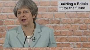 May urges developers to 'stop sitting on land and start building houses'