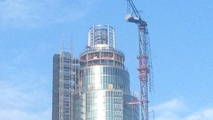 Broken jib of crane still hanging