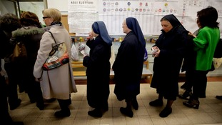 Nuns line up to vote at a polling station in Rome.