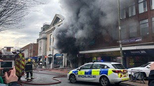 Roads closed as city centre bookstore on fire