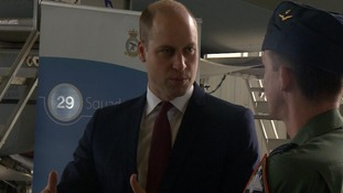 Prince William climbed into the cockpit of an RAF Typhoon jet as he visited RAF Coningsby.