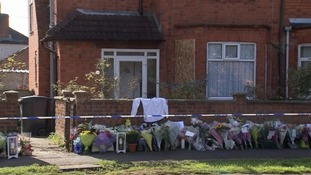 Tributes left at the scene in 2015.