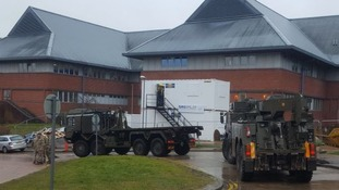 Armed forces vehicle arriving at Salisbury District Hospital.